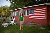 A girl vacations in Leech Lake, Minnesota - Stock Image - BRMHFN